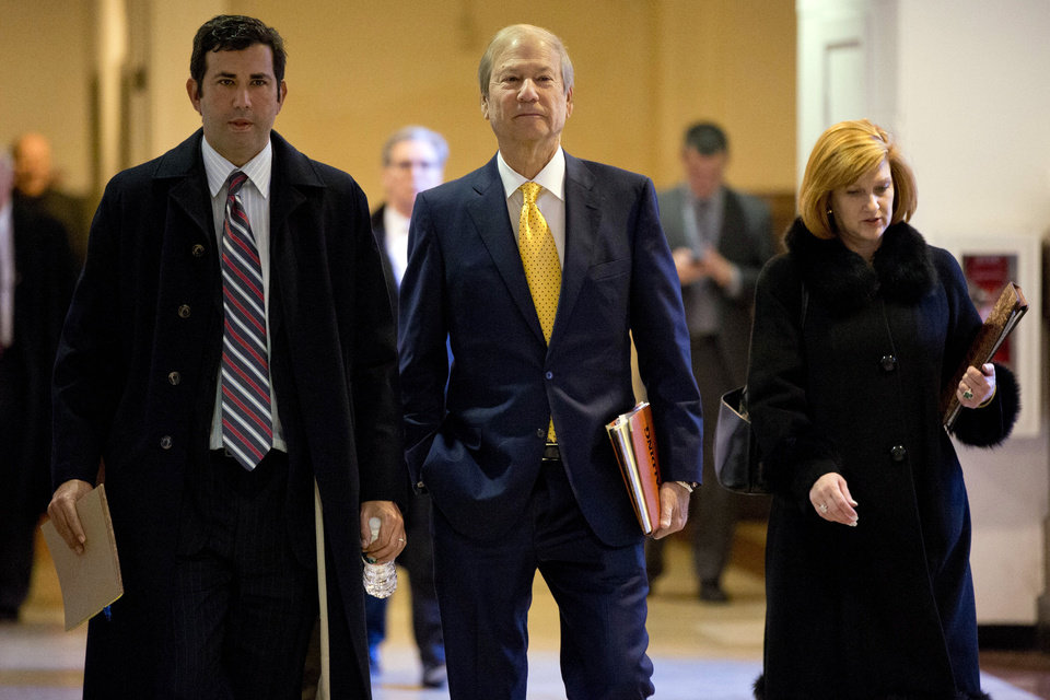 Photo - FILE - In this Nov. 13, 2013 file photo, businessman and co-owner of The Philadelphia Inquirer Lewis Katz, center, walks to Judge Patricia McInerney's courtroom  at City Hall in Philadelphia.  The editor of The Philadelphia Inquirer says co-owner Lewis Katz is among the seven people killed in a plane crash in Massachusetts.  Bill Marimow confirmed Katz's death to Philly.com on Sunday, June 1, 2014 saying he learned the news from close associates.  The plane crashed and caught fire as it was leaving Hanscom Field while on its way to Atlantic City International Airport. Massachusetts Port Authority spokesman Matthew Brelis says there were no survivors in the crash.  (AP Photo/Matt Rourke)