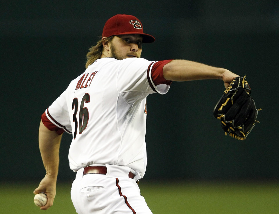 Photo - Arizona Diamondbacks starting pitcher Wade Miley (36) throws in the first inning against the San Francisco Giants during a baseball game, Tuesday, April 1, 2014, in Phoenix. (AP Photo/Rick Scuteri)