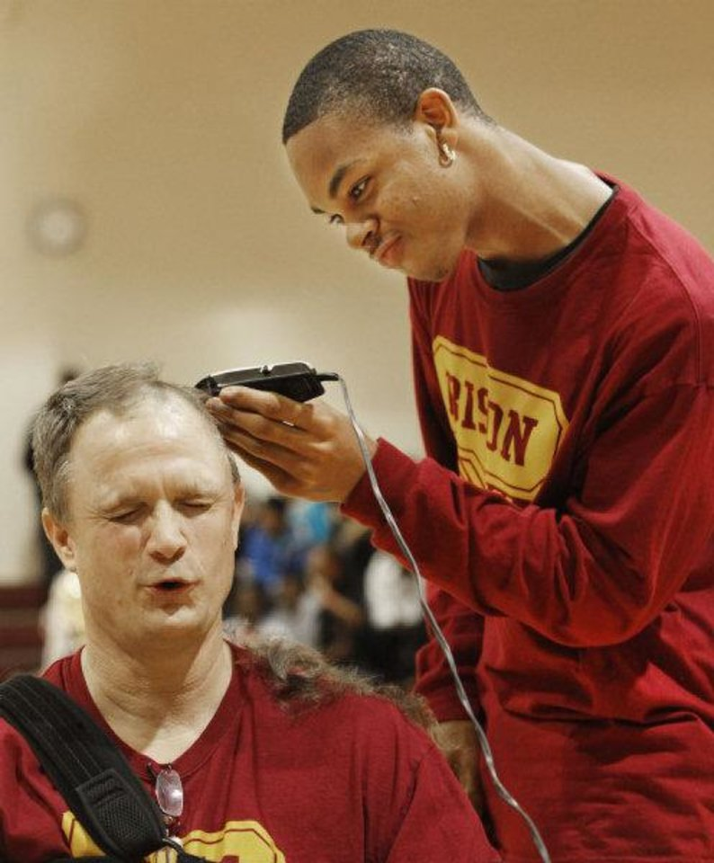HIGH SCHOOL BASKETBALL / STATE CHAMPIONSHIP / CELEBRATE / CELEBRATION: Coach Scott Raper gets his head shaved by senior Prince Thompson during an assembly celebrating the Centennial boys state basketball championship in Oklahoma City , March 25 , 2011. Photo by Steve Gooch, The Oklahoman <strong>Steve Gooch</strong>