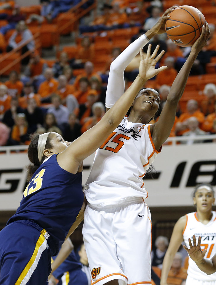 Oklahoma State's Toni Young (15) catches a pass over West Virginia's Ayana Dunning (33) during a women's college basketball game between Oklahoma State and West Virginia at Gallagher-Iba Arena in Stillwater, Okla.,  Tuesday, Jan. 29, 2013. West Virginia won 67-61. Photo by Bryan Terry, The Oklahoman