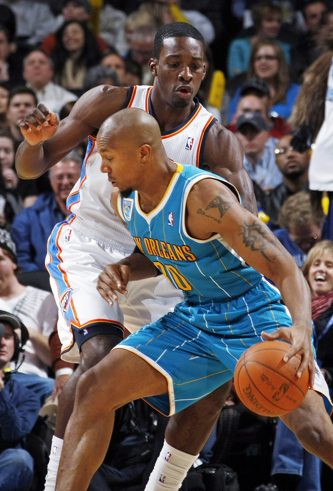 Oklahoma City's Jeff Green (22) defends David West (30) of New Orleans during the NBA basketball game between the New Orleans Hornets and the Oklahoma City Thunder at the Oklahoma City Arena in downtown Oklahoma City, Monday, Nov. 29, 2010. Photo by Nate Billings, The Oklahoman