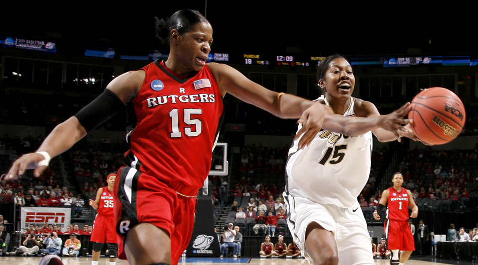 Photo - Rutgers' Kia Vaughn, left, and Purdue's Danielle Campbell go for the ball during the NCAA women's basketball tournament game between Rutgers and Purdue at the Ford Center in Oklahoma City, Sunday, March 29, 2009.  PHOTO BY BRYAN TERRY, THE OKLAHOMAN