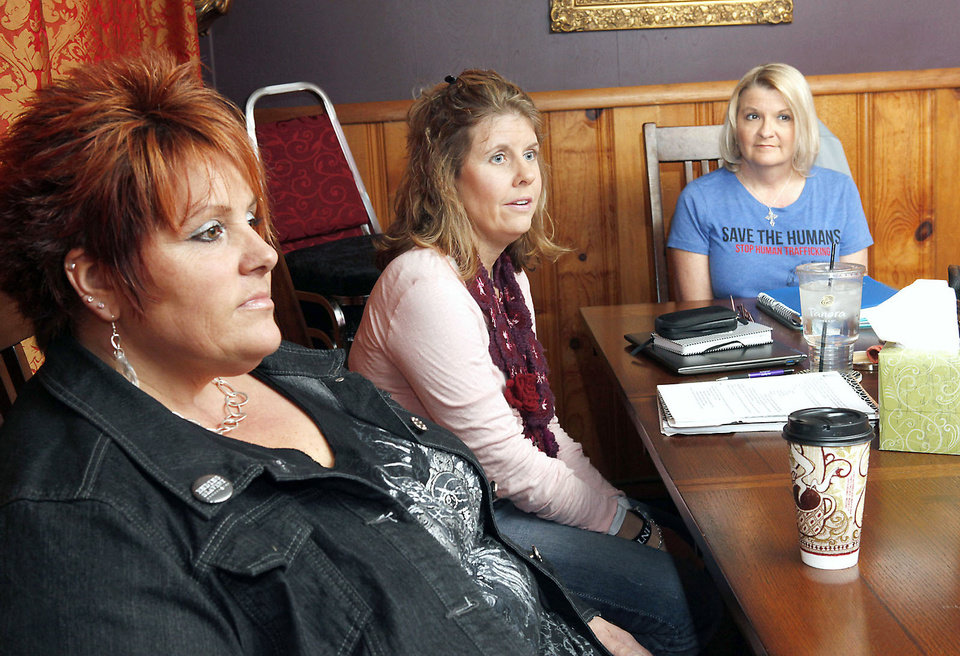 Photo - From left, Theresa Briscoe, Lori Basey and Debi Mangrum, with No Boundaries, talk last week about their new plan to get prostitutes off city streets with hot chocolate and opportunities for a better life. photos By Paul Hellstern, The Oklahoman