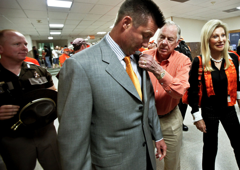Boone Pickens reaches over to straighten the collar of coach Mike Gundy's suit as they prepare to do the pre-game walk during game day. Photo by Chris Landsberger, The Oklahoman