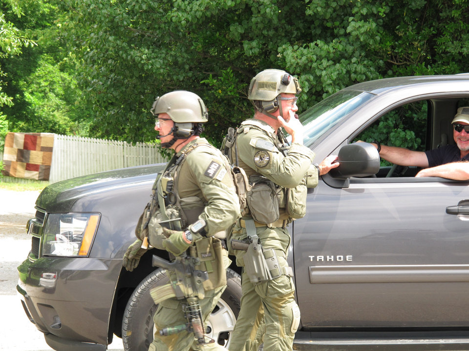 Photo -   FBI agents get ready to resume their search for a man accused of abducting a Tennessee mother and her three daughters on Tuesday, May 8, 2012 in Guntown, Miss. Authorities on Tuesday said they were searching for Adam Mayes 35, and two young girls, Alexandra Bain, 12, and Kyliyah Bain, 8. Teresa Mayes, 30, was charged with especially aggravated kidnapping and Mary Mayes, 65, was charged with conspiracy to commit kidnapping Tuesday, (AP Photo/Adrian Sainz)