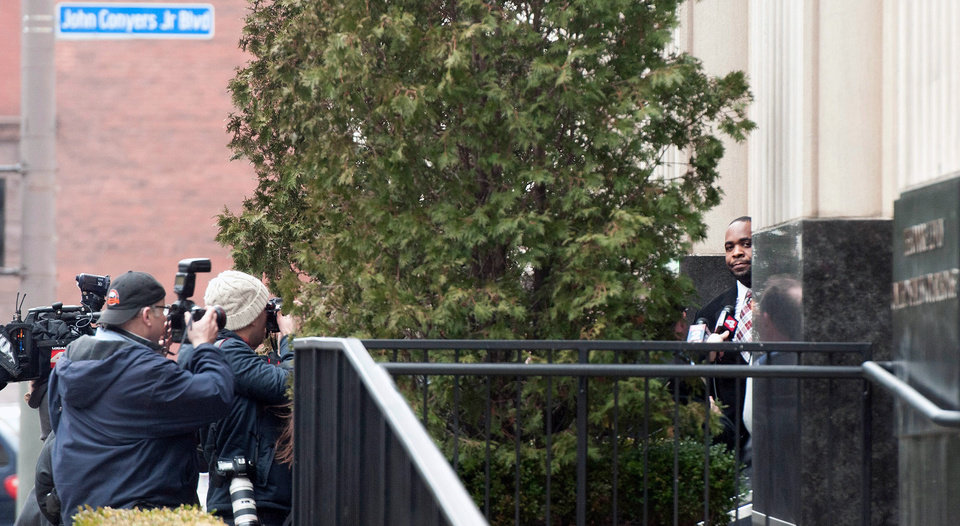 Ex- Detroit Mayor Kwame Kilpatrick peers out from the Theodore Levin Federal U.S. Courthouse in Detroit following his 6-month-long corruption trial  in which Kilpatrick was found guilty on 24 of 30 counts, including racketeering and extortion convictions on Monday, March, 11, 2013. Kilpatrick's long-time contractor friend, Bobby Ferguson was found guilty of 9 of 11 racketeering and extortion counts. Kwame Kilpatrick's father, Bernard Kilpatrick was convicted of 1 of 4 counts including filing a false tax return. (AP Photo/AnnArbor.com, Tanya Moutzalias)