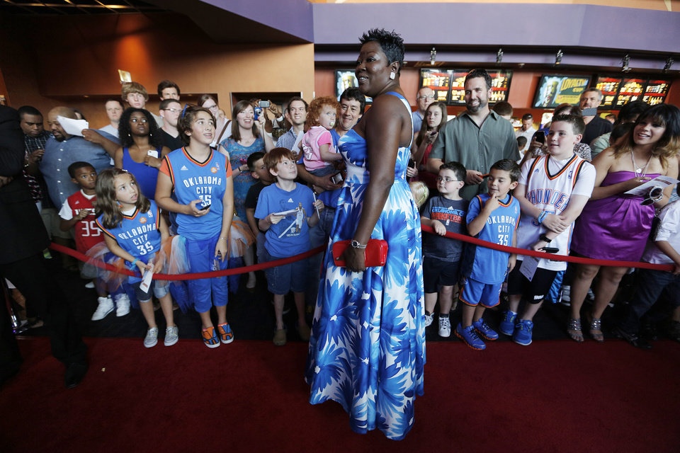 Wanda Pratt, mother of Kevin Durant, greets fans during the red carpet premiere of Thunderstruck at Harkins Bricktown Theatre in Oklahoma City, Sunday, Aug. 19, 2012.  Photo by Garett Fisbeck, For The Oklahoman