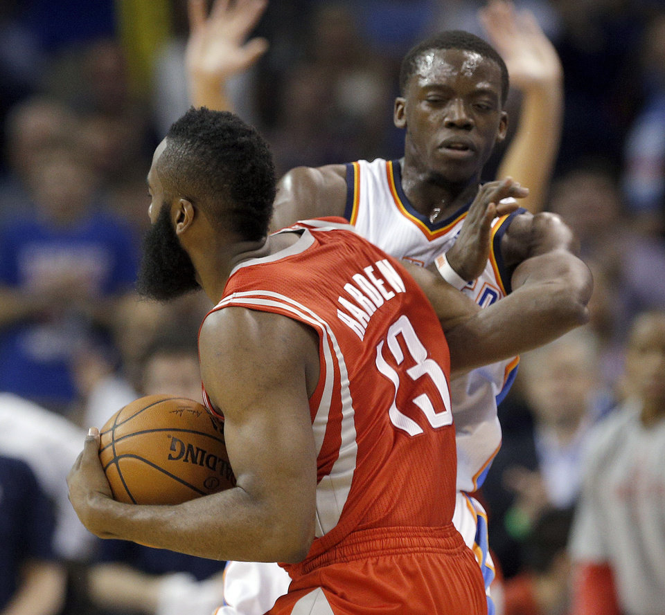 Photo - Oklahoma City's Reggie Jackson (15) and Houston's James Harden (13) shove each other during the NBA game between the Oklahoma City Thunder and Houston Rockets at the  Chesapeake Energy Arena  in Oklahoma City, Okla., Tuesday, March 11, 2014. Photo by Sarah Phipps, The Oklahoman