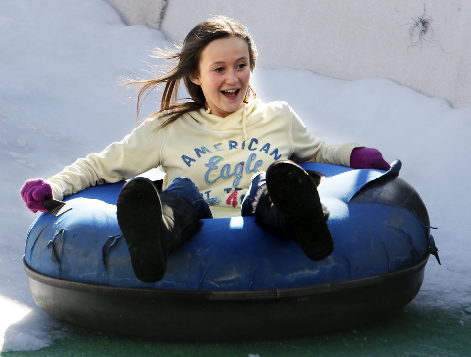Megan Gregory, 14, slides as sledders ride tubes down a man made snow slope at the Bricktown Ball Park on Wednesday, Jan. 1, 2014 in Oklahoma City, Okla. Photo by Steve Sisney, The Oklahoman