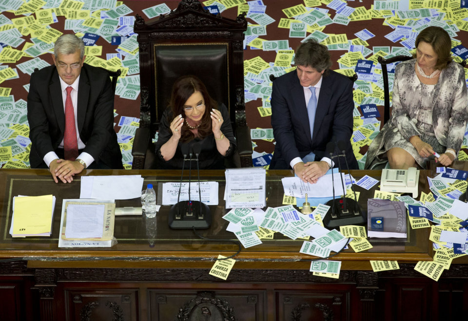 Argentina's President Cristina Fernandez, second left, gives a speech during the inauguration for the opening session of the Argentine National Congress in Buenos Aires, Argentina, Friday, March 1, 2013. Pictured second from right is Vice President Amado Boudou. (AP Photo/Victor R. Caivano)