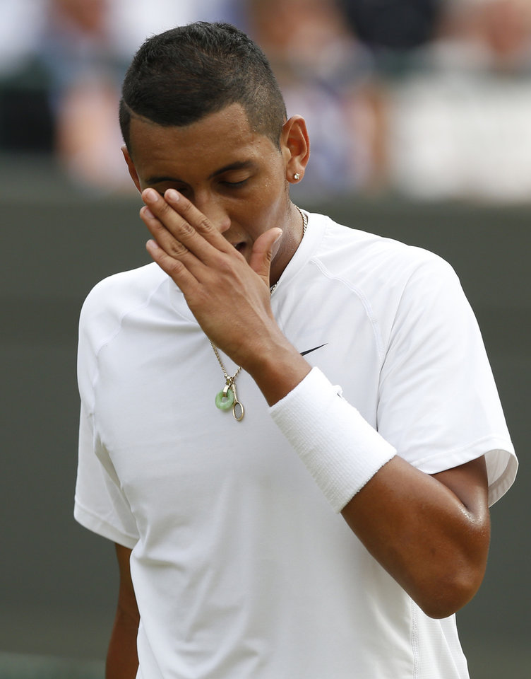 Photo - Nick Kyrgios of Australia reacts after losing a point to Milos Raonic of Canada during their men's singles quarterfinal match at the All England Lawn Tennis Championships in Wimbledon, London, Wednesday, July 2, 2014. (AP Photo/Ben Curtis)