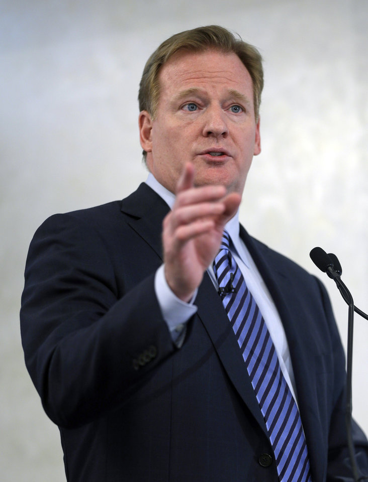 Photo - NFL Commissioner Roger Goodell speaks during an NFL football news conference in New York, Monday, March 11, 2013. The NFL is partnering with private companies as well as the U.S. Military to further research on head injuries. (AP Photo/Seth Wenig)