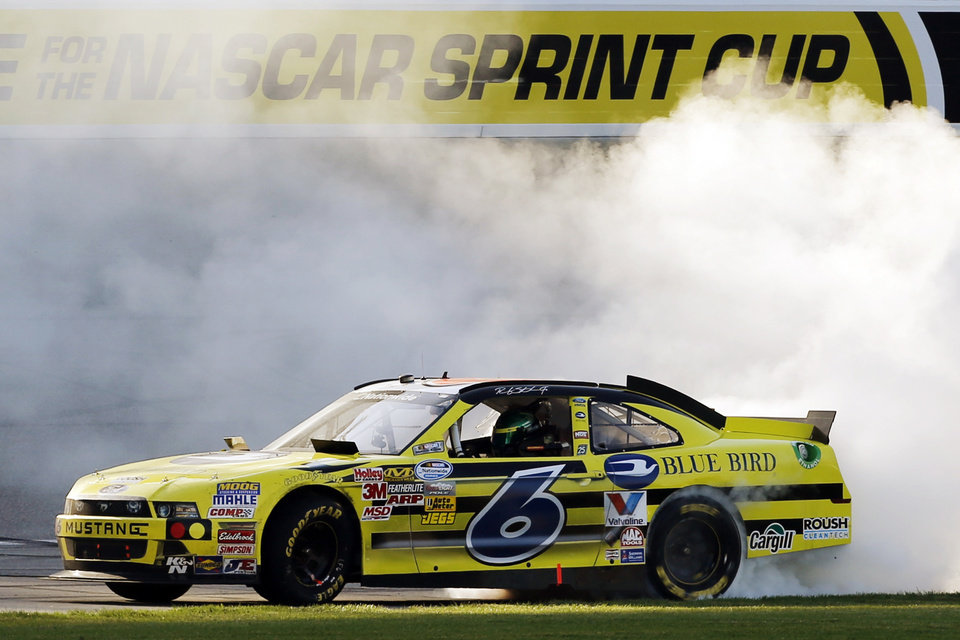 Photo -   Ricky Stenhouse Jr., (6) performs a burnout after winning the NASCAR Nationwide Series auto race at Chicagoland Speedway in Joliet, Ill., Saturday, Sept. 15, 2012. (AP Photo/Skip Stewart)