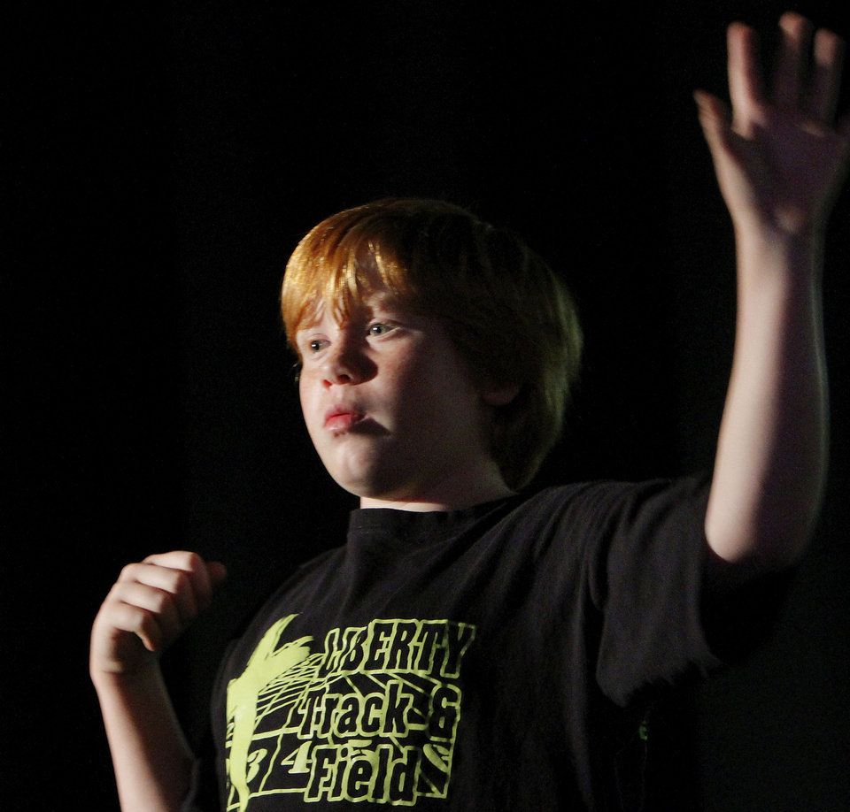 Photo - Aaron Ellis rehearses his part in the play during the summer arts program at Mabee-Gerrer Museum of Art on the St. Gregory's University campus in Shawnee.