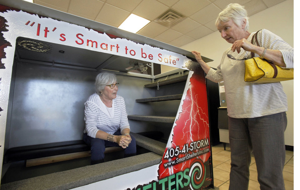 Sandra Blackstock, right, helps Elizabeth Prosser of Oklahoma City shop for a storm shelter at Smart Shelters in Oklahoma City. <strong>Aliki Dyer - The Oklahoman</strong>