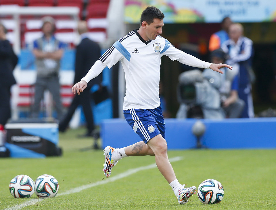 Photo - Argentina's Lionel Messi, right, kicks a ball  during a training session at the Beira-Rio Stadium in Porto Alegre, Brazil, Tuesday, June 24, 2014.  Argentina plays in group F of the 2014 soccer World Cup. (AP Photo/Victor R. Caivano)