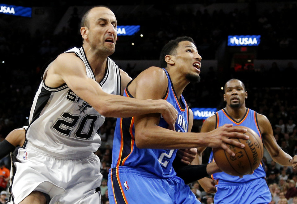Photo - Oklahoma City's Andre Roberson (21) is fouled by San Antonio's Manu Ginobili (20) during Game 2 of the second-round series between the Oklahoma City Thunder and the San Antonio Spurs in the NBA playoffs at the AT&T Center in San Antonio, Monday, May 2, 2016. Photo by Bryan Terry, The Oklahoman