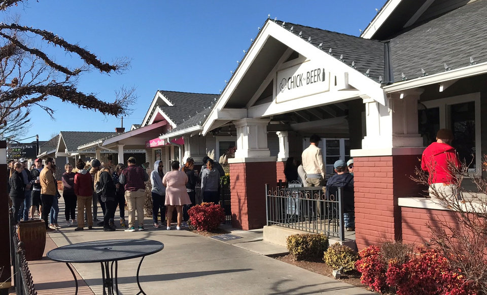 Photo - A hungry throng lines up outside ChickNBeer waiting for spicy wings and okra from celebrity chef Danny Bowien on New Year's Day in Oklahoma City. [Dave Cathey/The Oklahoman]