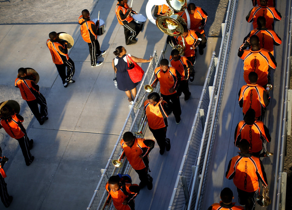 Photo - The Douglass band makes their way to the stands before a high school football game between Douglass and Booker T. Washington at Douglass in Oklahoma City, Friday, September 6, 2013. Photo by Bryan Terry, The Oklahoman
