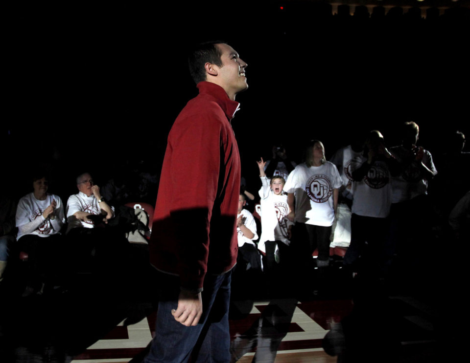 Photo - Former Oklahoma quarterback Sam Bradford is introduced to the crowd during halftime of the NCAA college basketball game between the University of Oklahoma Sooners and Texas Longhorns at Lloyd Noble Center in Norman, Okla., Wednesday, Feb. 9, 2011. Photo by Bryan Terry, The Oklahoman