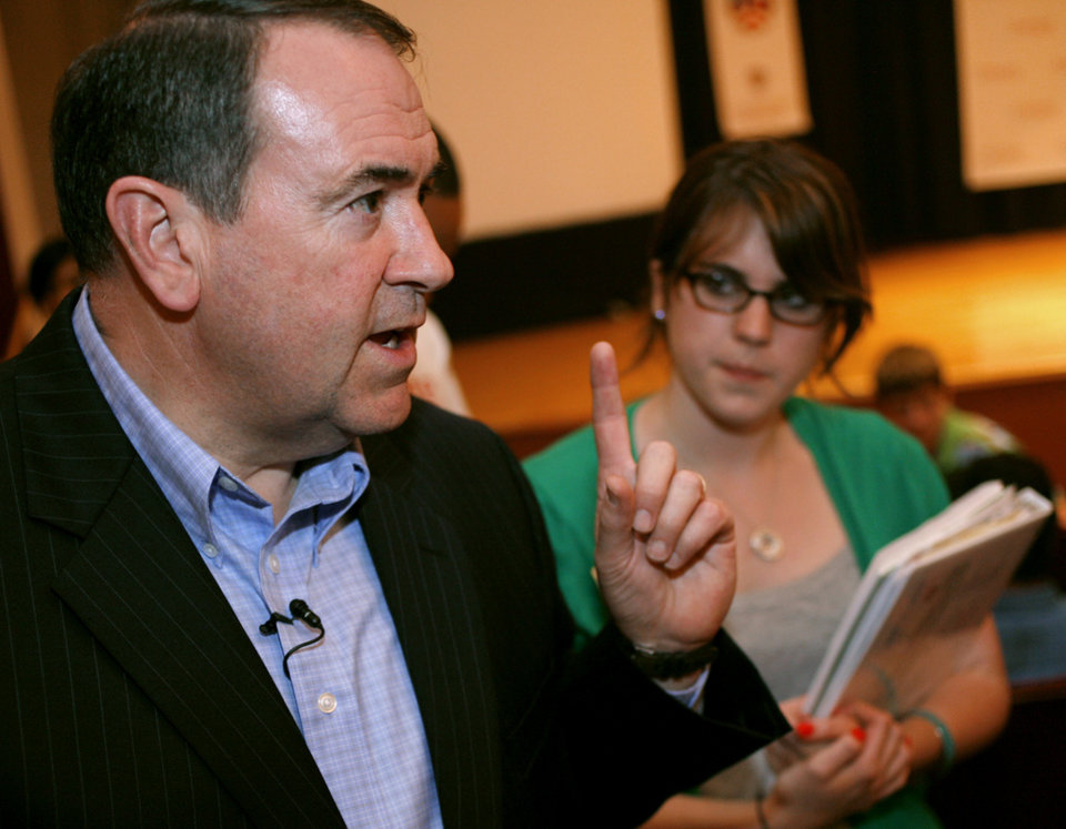Photo - STATE VISIT: Michela Smith, a student from Andover, Mass., listens to former Arkansas Governor Mike Huckabee as he speaks to high school students at Oklahoma Christian University in Edmond on Sunday, July 12, 2008. By John Clanton, The Oklahoman ORG XMIT: KOD