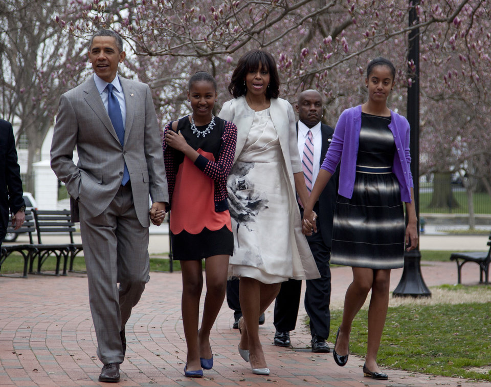 President Barack Obama and first lady Michelle Obama walk from the White House with their daughters Sasha Obama, second from left, and Malia Obama, right, on their way through Lafayette Park to St. John\'s Episcopal Church for Easter services, Sunday, March 31, 2013, in Washington. (AP Photo/Carolyn Kaster)