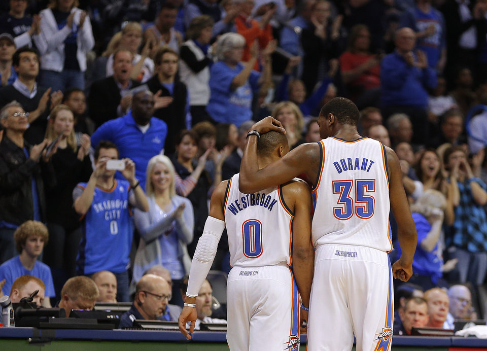 OKC�s Russell Westbrook, left, and Kevin Durant walk off the court after a time out during Thursday night�s 107-95 win over the Bulls.  Photo by Bryan Terry, The Oklahoman