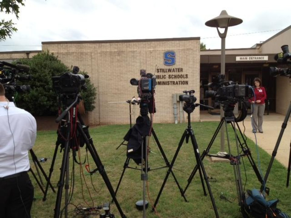 School officials prepare to address the media in Stillwater today. Photo by Jim Beckel