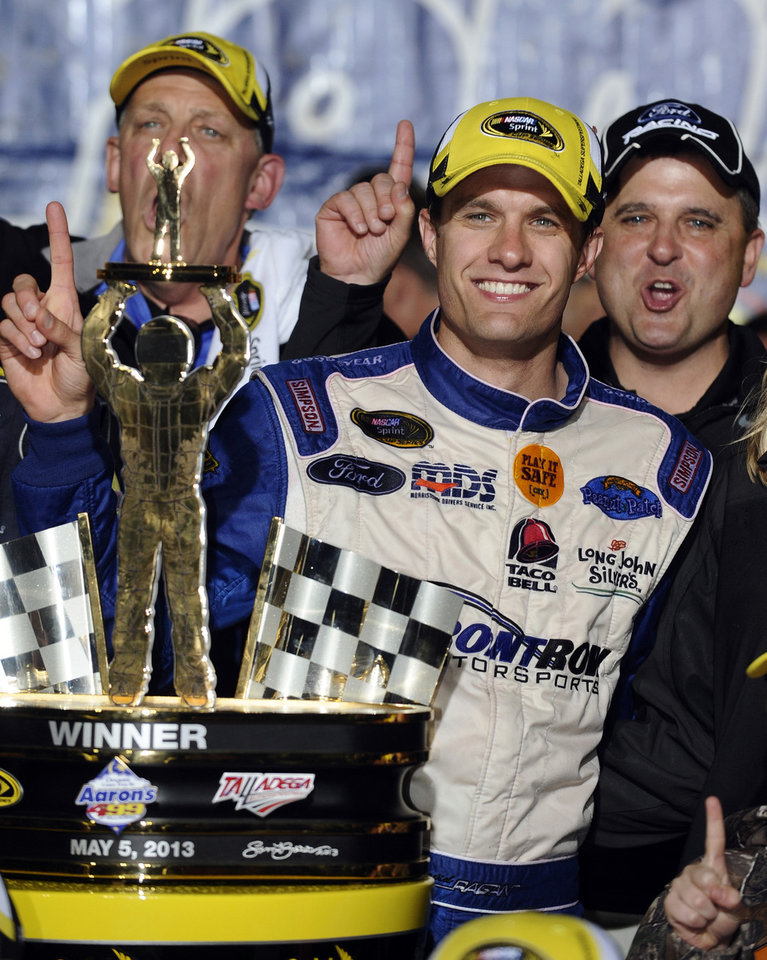 Photo - David Ragan celebrates in Victory Lane after winning the NASCAR Sprint Cup Series Aaron's 499 auto race at the Talladega Superspeedway in Talladega, Ala., Sunday, May 5, 2013. (AP Photo/Rainier Ehrhardt)