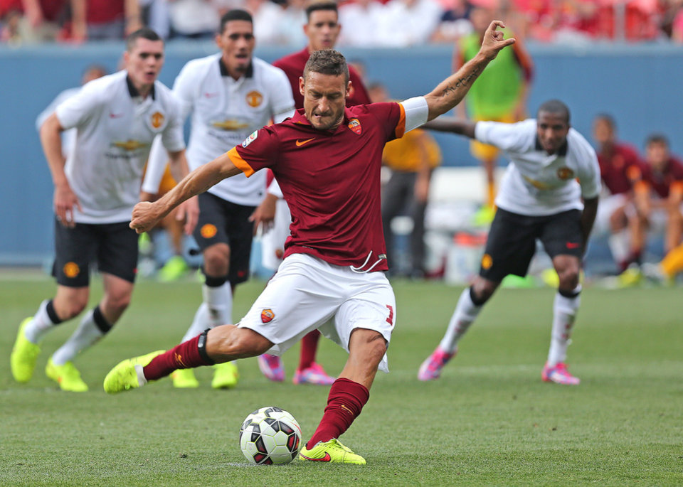 Photo - FILE - In this July 26, 2014 file photo, AS Roma's Francesco Totti kicks for a goal during an exhibition soccer match against Manchester United at Mile High Stadium in Denver, Co. For Italian football fans, merely mentioning the word