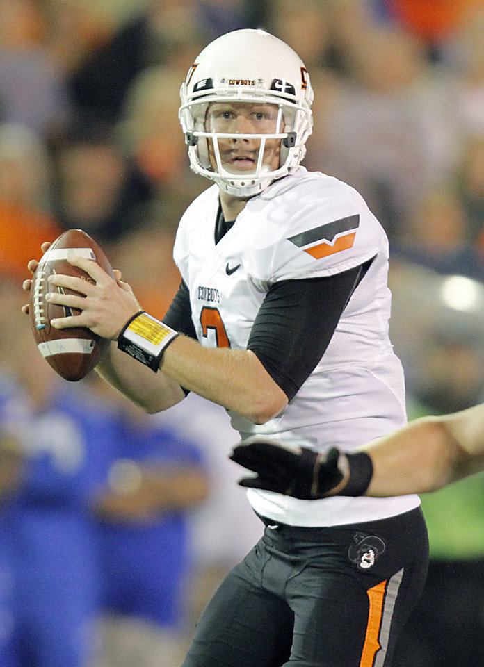 Photo - Oklahoma State's Brandon Weeden (3) looks to pass the ball against Tulsa during a college football game between the Oklahoma State University Cowboys and the University of Tulsa Golden Hurricane at H.A. Chapman Stadium in Tulsa, Okla., Sunday, Sept. 18, 2011. Photo by Chris Landsberger, The Oklahoman