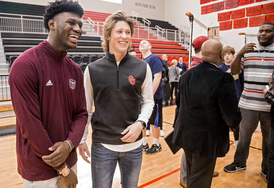 Photo - Westmoore's Damoriea Vick, left, and Braxton Bohrofen laugh as they pose for photos after they signed their national letters of intent during national signing day at Westmoore High School in Moore, Okla. on Wednesday, Feb. 7, 2018. Vick signed to play football for Missouri State University, and Bohrofen signed to play baseball for the University of Oklahoma. Photo by Chris Landsberger, The Oklahoman