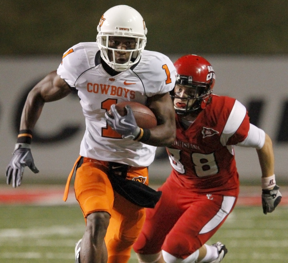 Photo - OSU's Joseph Randle runs past  Louisiana-Lafayette's Cooper Gerami during the football game between the University of Louisiana-Lafayette and Oklahoma State University at Cajun Field in Lafayette, La., Friday, October 8, 2010. Photo by Bryan Terry, The Oklahoman