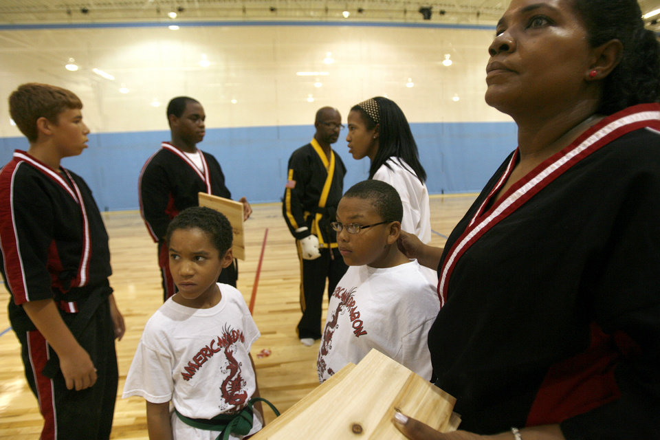 Photo - The karate group at the Boys & Girls Club on N Western in Oklahoma City gather together to break some wooden boards Monday, July 27, 2009. By Ashley McKee, The Oklahoman ORG XMIT: KOD