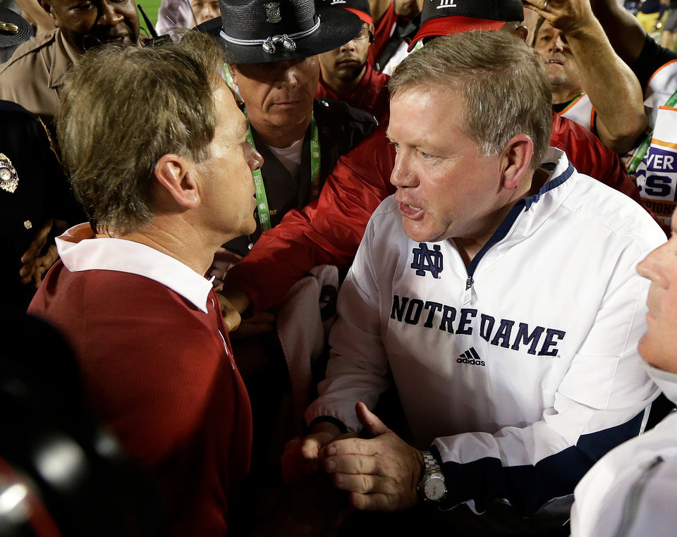 Photo - Alabama head coach Nick Saban shakes hands with Notre Dame head coach Brian Kelly after the BCS National Championship college football game Monday, Jan. 7, 2013, in Miami. Alabama won 42-14. (AP Photo/David J. Phillip)