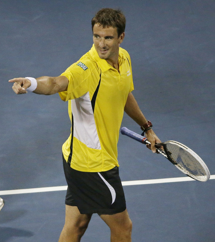 Photo - Tommy Robredo, of Spain, reacts after beating Roger Federer, of Switzerland, in straight sets during the fourth round of the 2013 U.S. Open tennis tournament, Monday, Sept. 2, 2013, in New York. (AP Photo/David Goldman)