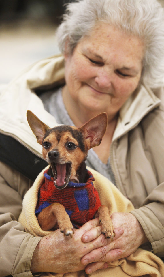 Faye Barnett, of  Chickasha, holds her dog Bozo, 2, on Friday at the shelter in Chickasha. Photo by Jaconna Aguirre,  The Oklahoman