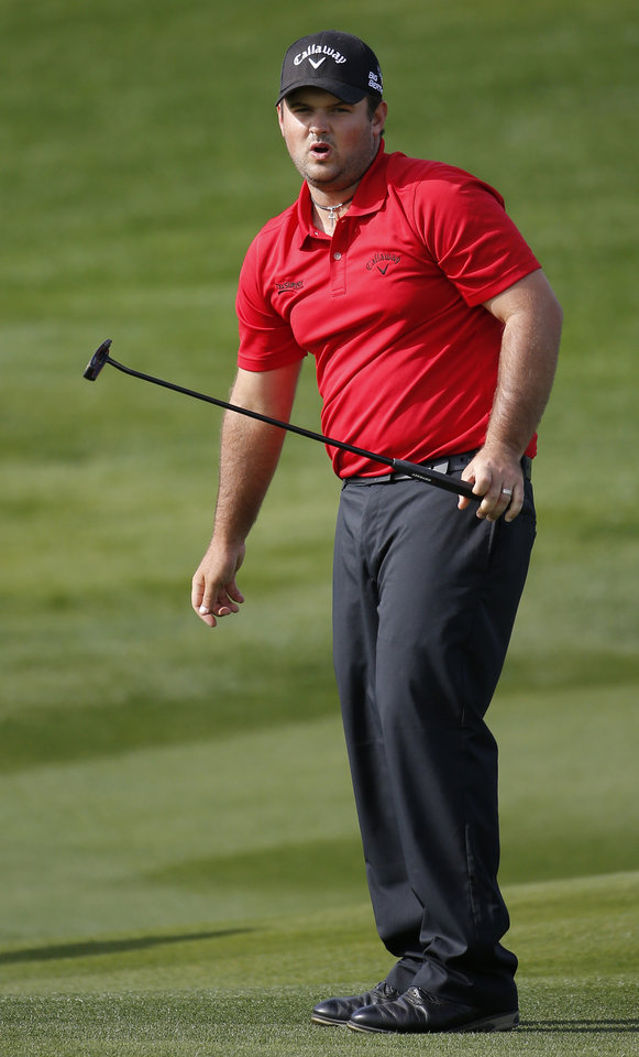 Photo - Patrick Reed reacts after missing his par putt on the seventh hole hole during the final round of the Humana Challenge golf tournament on the Palmer Private course at PGA West, Sunday, Jan. 19, 2014, in La Quinta, Calif. (AP Photo/Matt York)