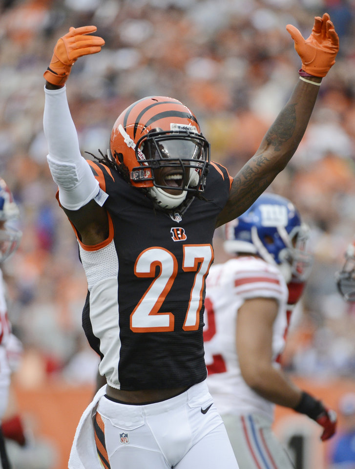 Photo -   Cincinnati Bengals cornerback Dre Kirkpatrick celebrates after making a play against the New York Giants in the first half of an NFL football game, Sunday, Nov. 11, 2012, in Cincinnati. Kirkpatrick, the Bengals top draft pick, was seeing his first significant action of the season coming off a pre-season injury. (AP Photo/Michael Keating)