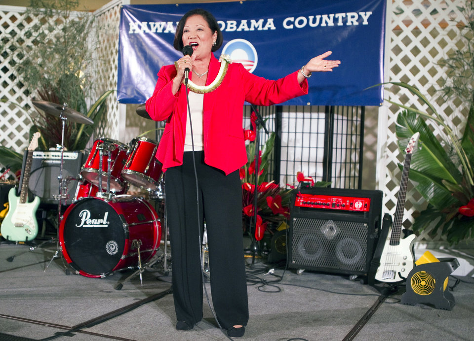 Photo -   FILE - In this Tuesday, Nov. 6, 2012 file photo, U.S. Rep. Maize Hirono gives a victory speech at the Japanese Cultural Center in Honolulu. Hirono will be one of a record 20 women, and the first Asian-American woman, in the next Senate, 17 of them Democrats. (AP Photo/Marco Garcia)