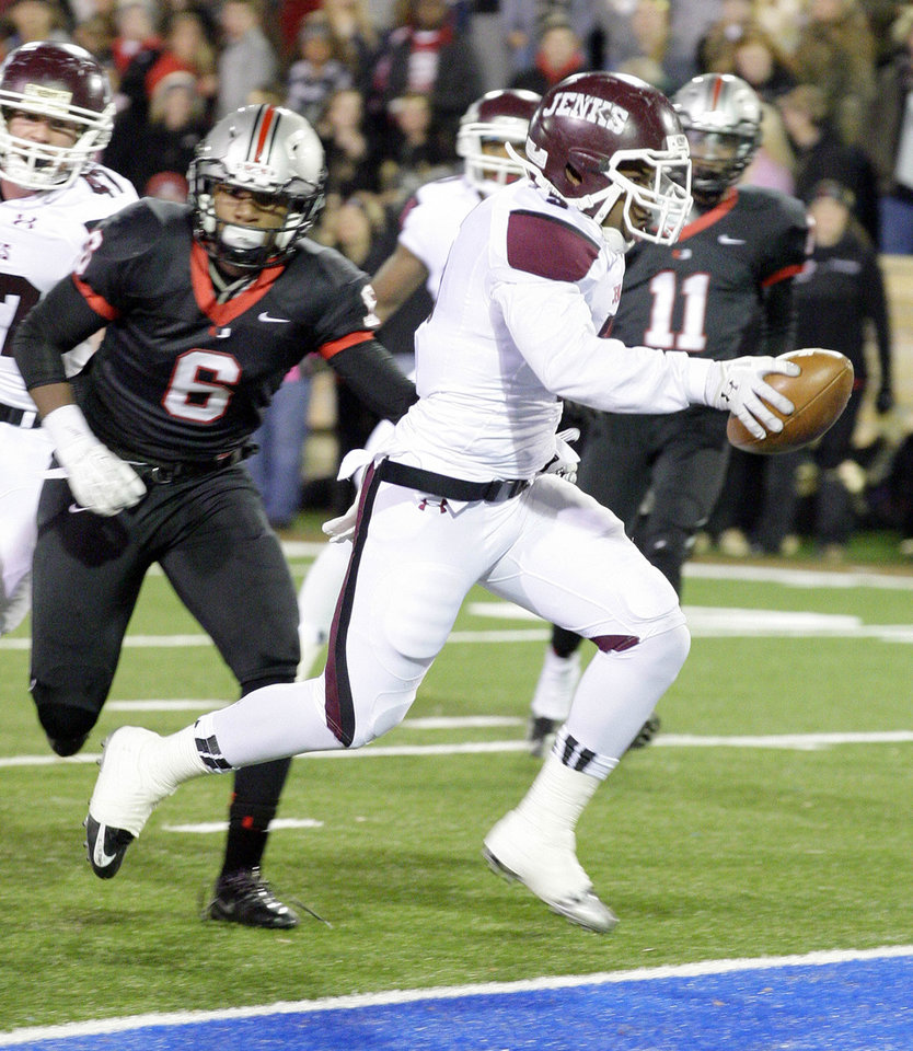 Photo - Jenks' Cameron Booty runs in a touchdown in front of Union's Bradon Golpin (6) and Robert Thomas (11) during their 6A state championship game played at the University of Tulsa in Tulsa, OK, Dec. 12, 2013. MICHAEL WYKE/Tulsa World