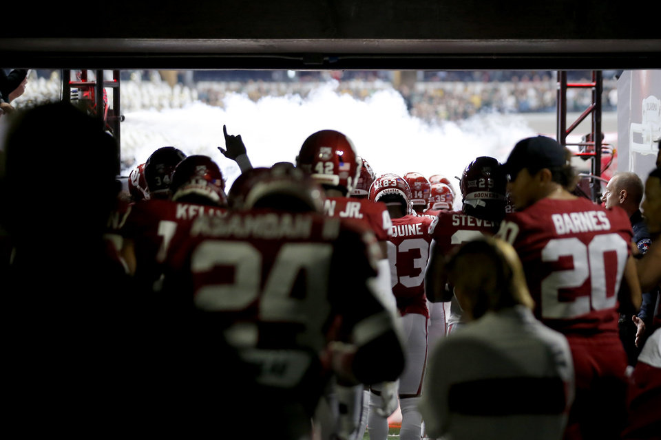 Photo - Oklahoma takes the field before the Big 12 Championship Game between the University of Oklahoma Sooners (OU) and the Baylor University Bears at AT&T Stadium in Arlington, Texas, Saturday, Dec. 7, 2019. Oklahoma won 30-23. [Bryan Terry/The Oklahoman]