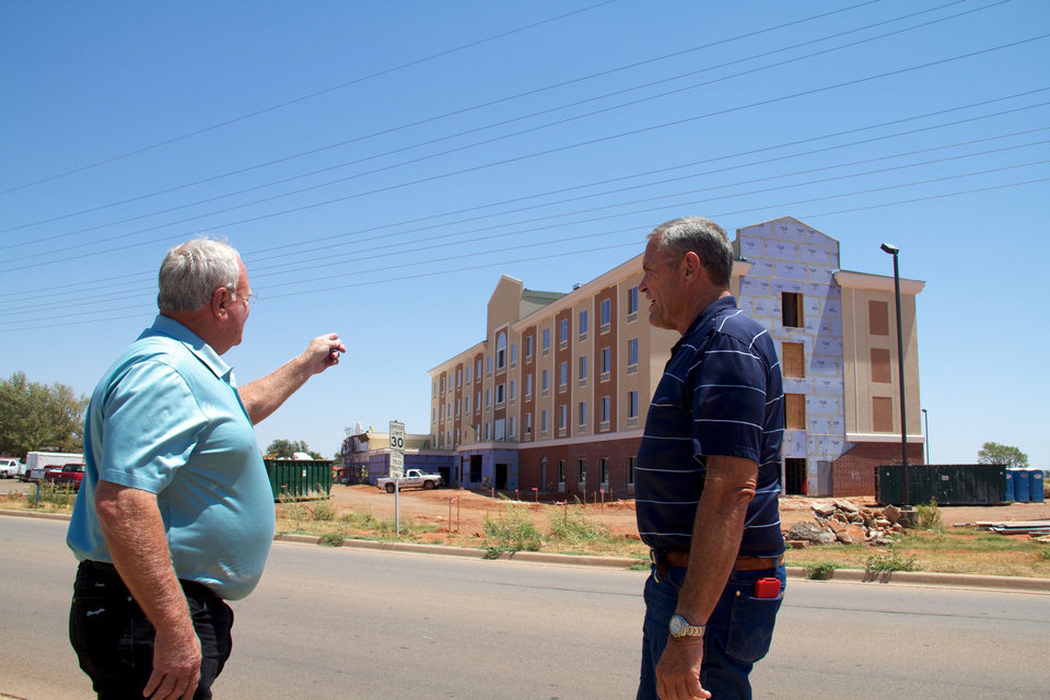 Elk City commissioners Tom Mike Johnson and Allen Robinson inspect new Holiday Inn under construction in Elk City.