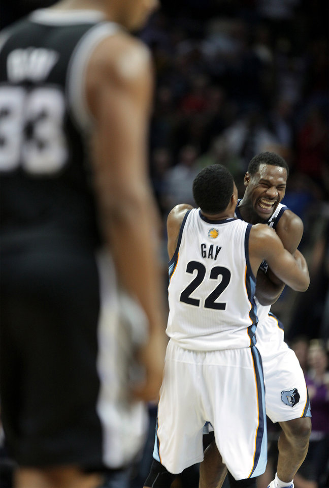 Photo - Memphis Grizzlies forward Rudy Gay (22) hugs teammate Tony Allen after stopping a shot by the San Antonio Spurs in overtime during an NBA basketball game on Friday, Jan. 11, 2013, in Memphis, Tenn. Memphis won in overtime 101-98. (AP Photo/Lance Murphey)