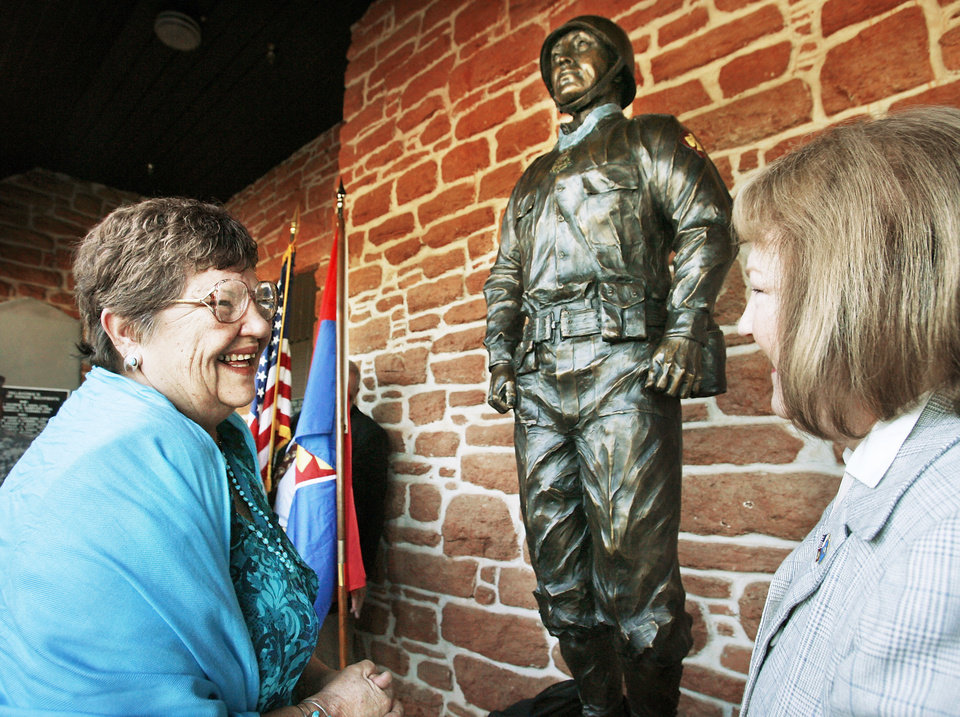 Photo - Above: Yolanda Elaine Childers, left, of Tulsa,  expresses her delight with a statue of her father, Ernest Childers, with sculptor Sandra Van Zandt after its debut Friday. PHOTO BY Jim Beckel, The Oklahoman