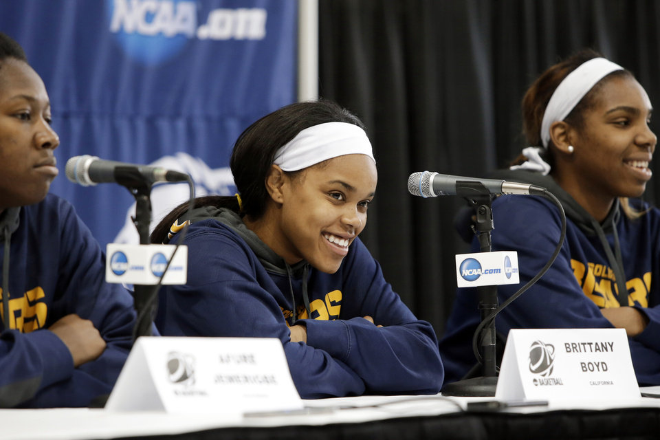 Photo - California's Afure Jemerigbe, from left, Brittany Boyd and Reshanda Gray take questions during an NCAA college basketball tournament news conference, Sunday, March 23, 2014, in Waco, Texas. California is scheduled to play Baylor on Monday. (AP Photo/Tony Gutierrez)