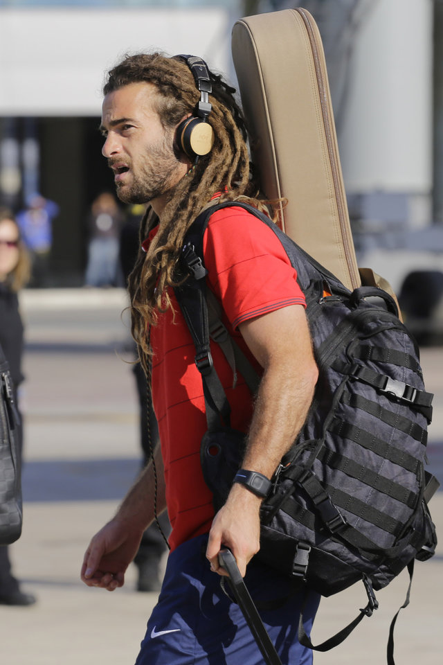 Photo - United States' national soccer team player Kyle Beckerman arrives at the Sao Paulo International airport in Brazil, Monday, June 9, 2014. U.S. team arrived in Sao Paulo to continue their preparations for the upcoming Brazil 2014 World Cup, which starts on June 12. (AP Photo/Nelson Antoine)