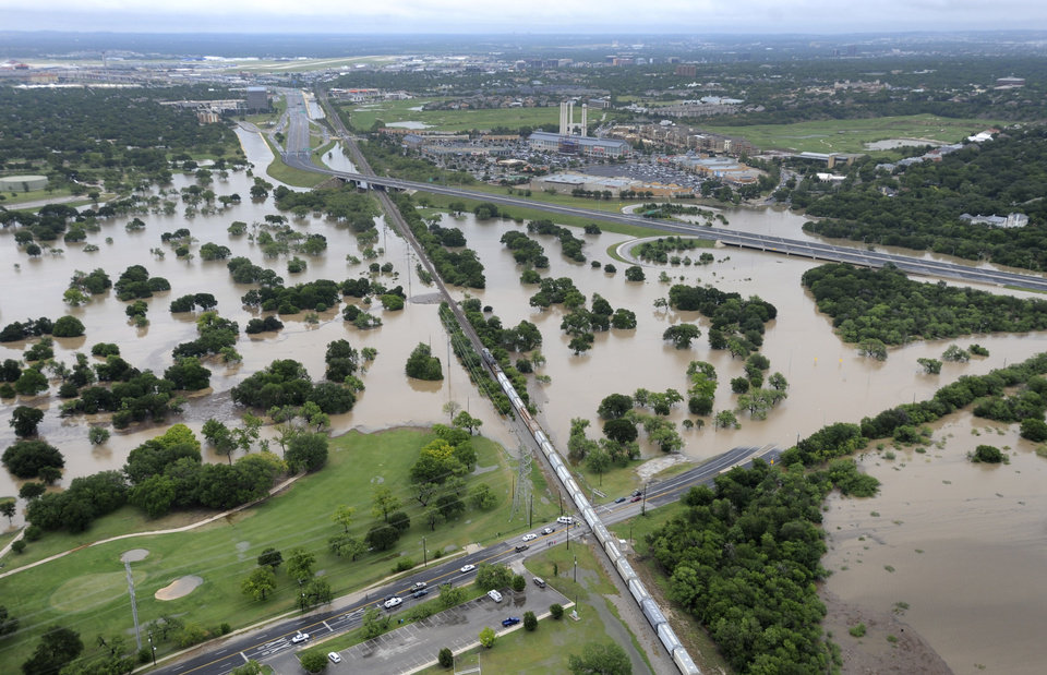 Photo - The Olmos Basin Municipal Golf Course and Basse Road in San Antonio are underwater Saturday May 25, 2013 as a result of heavy rains in San Antonio. Saturday was the second wettest day in San Antonio history with the National Weather Service recording 9.83 inches of rain by 10:30 a.m. (AP Photo/San Antonio Express-News, Billy Calzada)   RUMBO DE SAN ANTONIO OUT; NO SALES   MBO