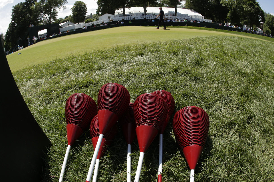 Photo - Ian Poulter, of England, walks past wicker baskets during practice for the U.S. Open golf tournament at Merion Golf Club, Wednesday, June 12, 2013, in Ardmore, Pa. (AP Photo/Charlie Riedel)