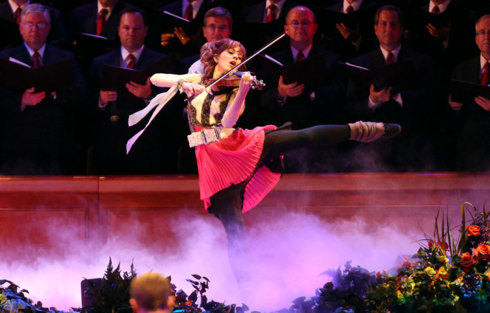 Photo -       Lindsey Stirling performs with the Mormon Tabernacle Choir and Orchestra at Temple Square for a Pioneer Day concert at the LDS Conference Center in Salt Lake City on Friday, July 19, 2013.